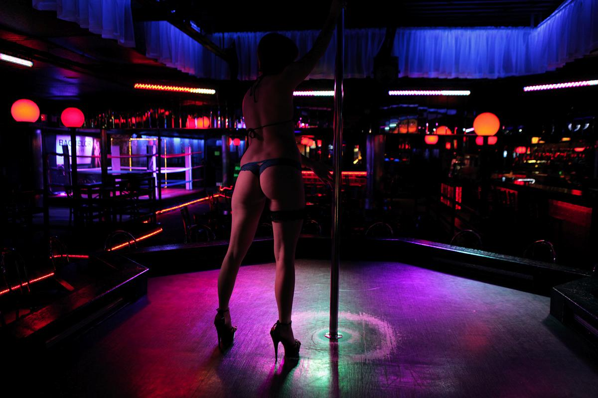Strip club reopens with masks on, clothes off party